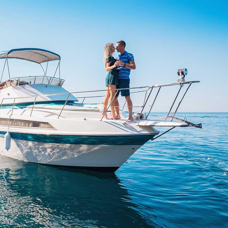 Couple dancing on boat